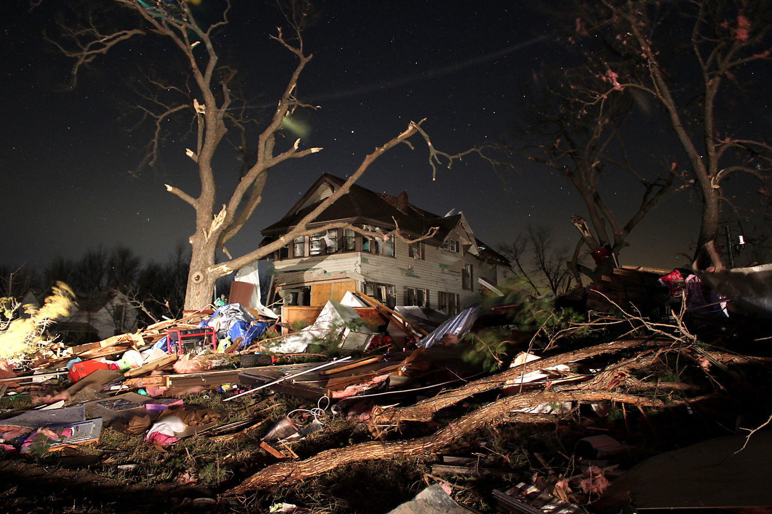Feb. 29, 2012. Broken branches and household debris are scattered across a lawn  in Harveyville, Kan., after an apparent tornado passed through the town.