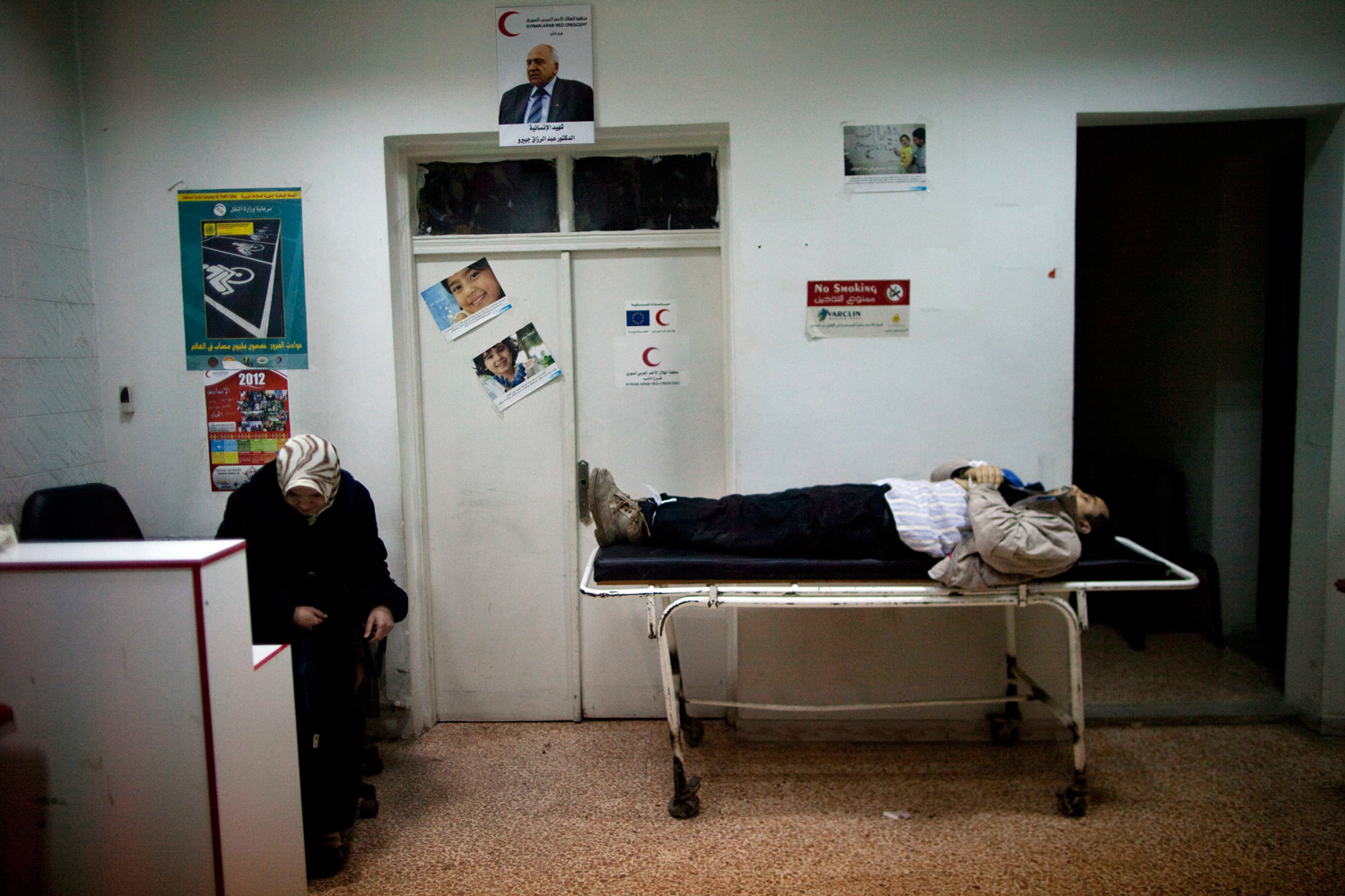 March 11, 2012. The wife of Mohammed Halak slumps in a chair next to his body as she mourns the death of her husband.