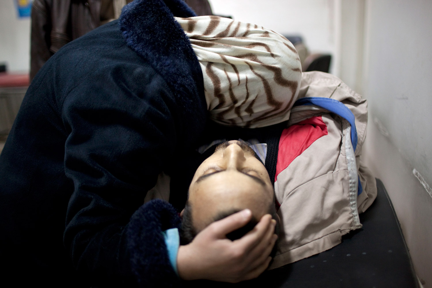 March 11, 2012. The wife of Mohammed Halak mourns after the man was killed by gunfire during fierce fighting between the Free Syrian Army and the government forces in Idlib, north Syria.