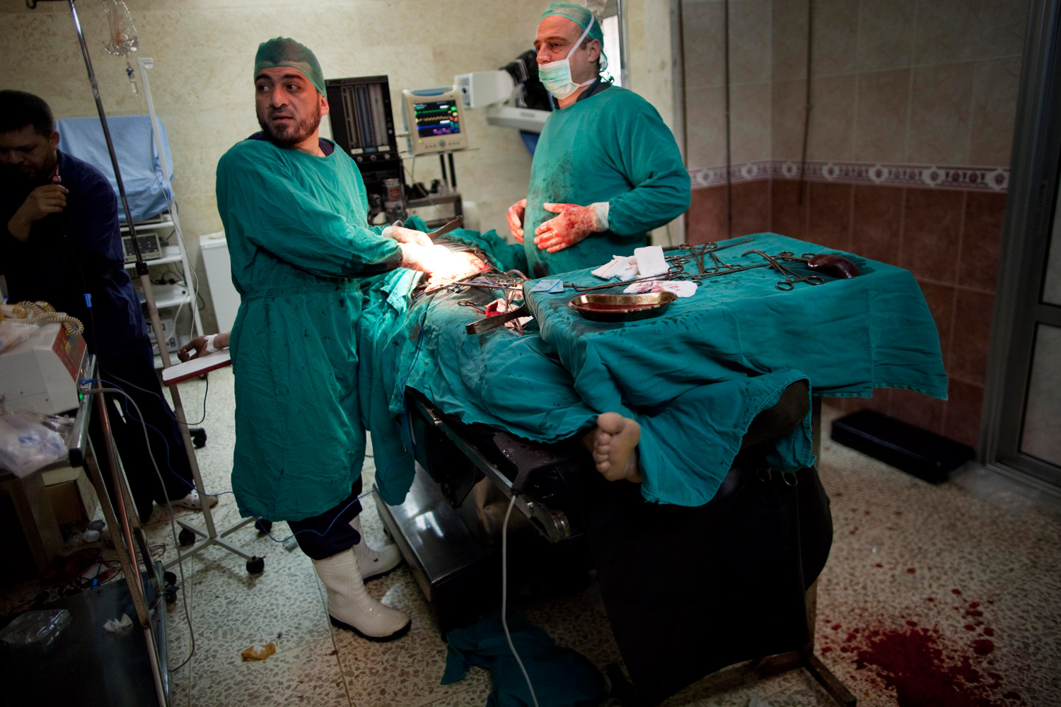 March 10, 2012. Doctors try to save the life of a severely wounded Free Syrian Army fighter during fighting against government troops in Idlib, Syria.