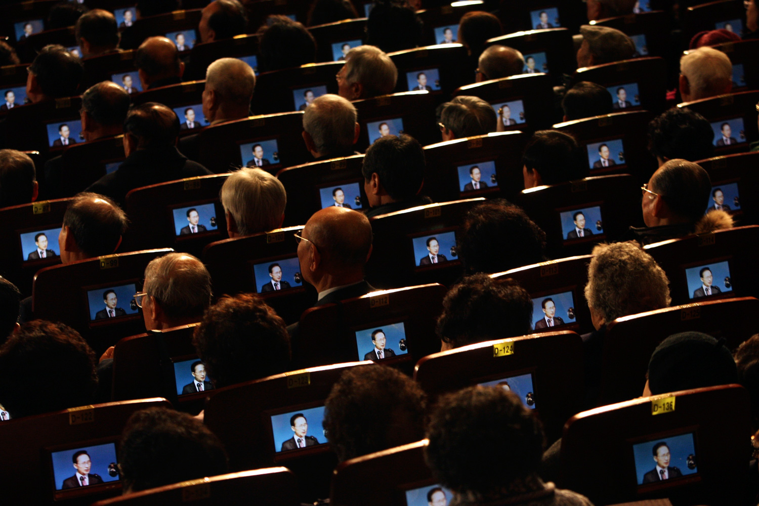 March 1, 2012. Small screens show South Korean President Lee Myung-bak as participants listen to his speech during the 93th anniversary ceremony of Independence Movement Day, a public holiday to remember activists who fought for Korean independence against Japanese colonization, in Seoul.