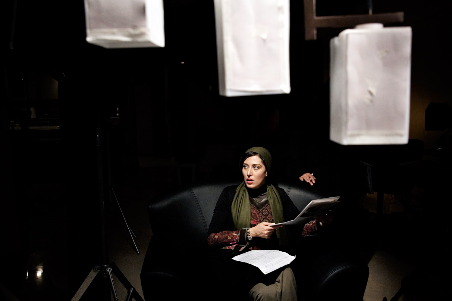 Actress Mahtab Karamati prepares for a scene on the set of director Rusagh Karimi's film The Hidden Meaning in Tehran.
