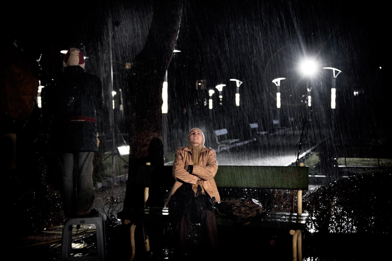 Actress Bita Saharkhiz performs on set during the filming of director Kamal Tabrizi's Grain's Scent in Tehran.
