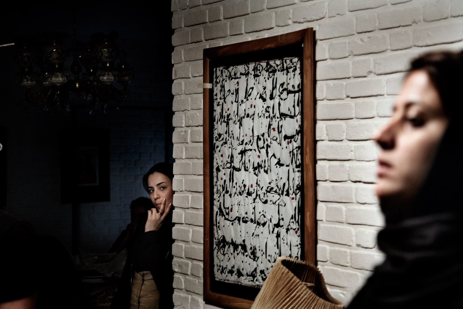 Actresses stand on set during the filming of A Woman Is Always Involved by Kamal Tabrizi in Tehran.