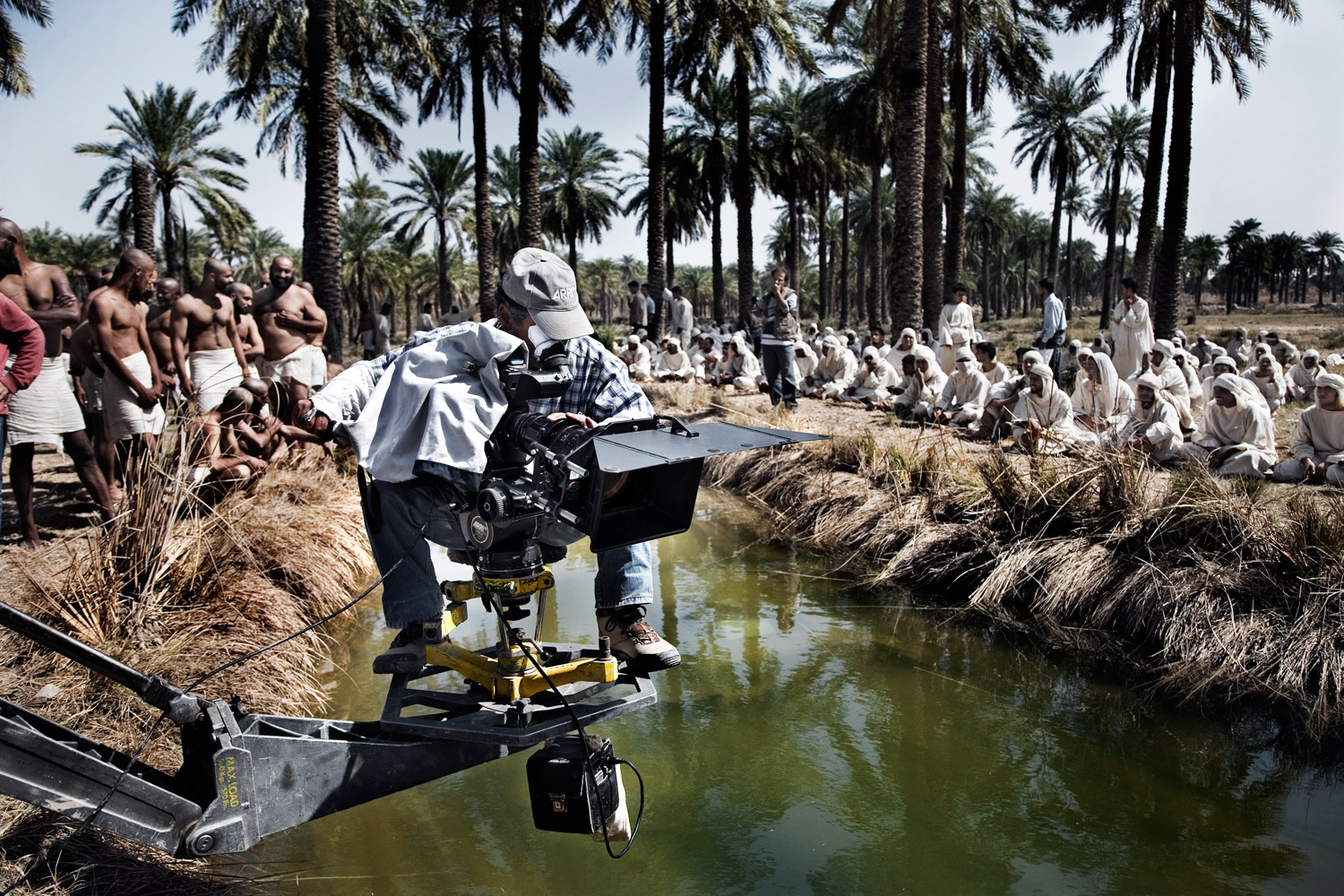 A cinematographer sets up a scene on the set of the colossal movie Moktar on the Iran-Iraq border in Abadan, Iran.