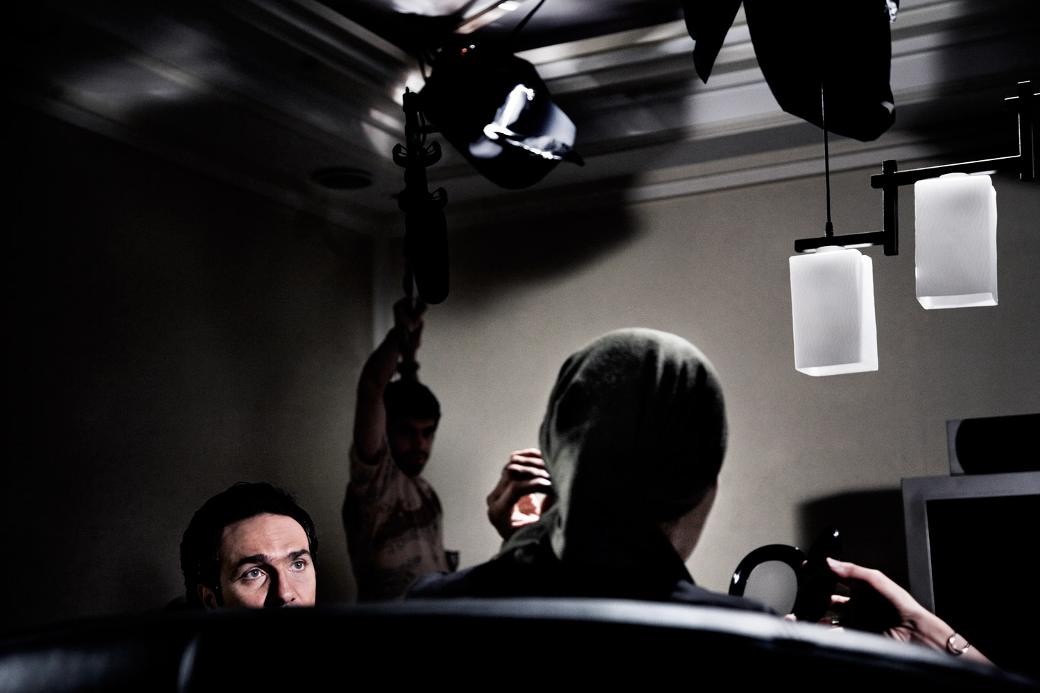 A production crew prepares for a scene on the set of director Rusagh Karimi's film The Hidden Meaning in Tehran.