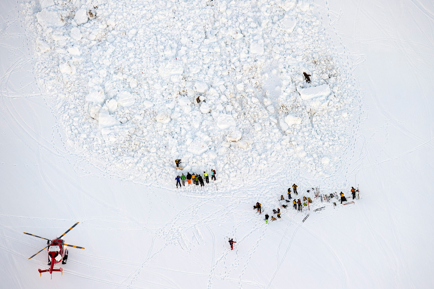 Feb. 29, 2012. An aerial view shows rescuers searching for persons under an avalanche at Col de la Croix in the Skiing area The Diablerets, Switzerland.