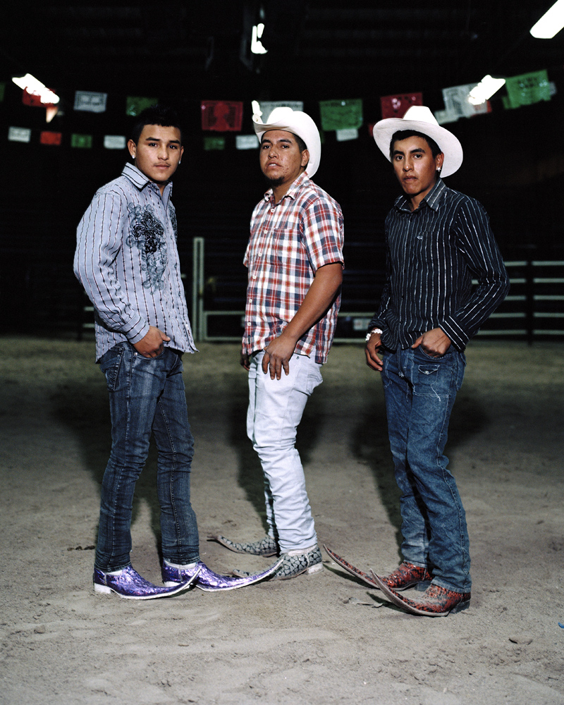Three young clubbers from a neighboring village of Matehuala posing inside the  Mesquit Rodeo  club.