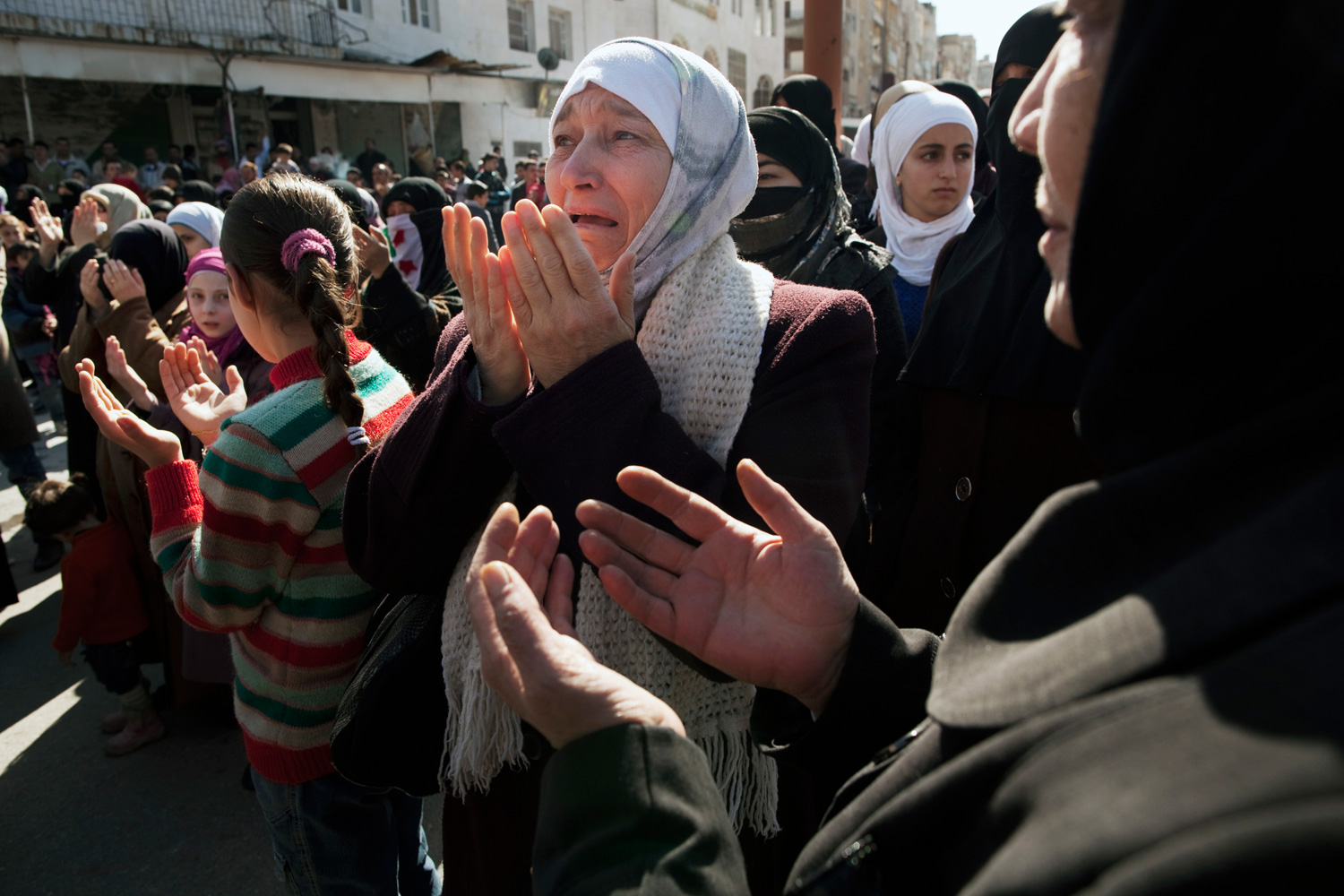 March 9, 2012. A woman weeps as she prays during an anti-government demonstration in Idlib, north Syria.