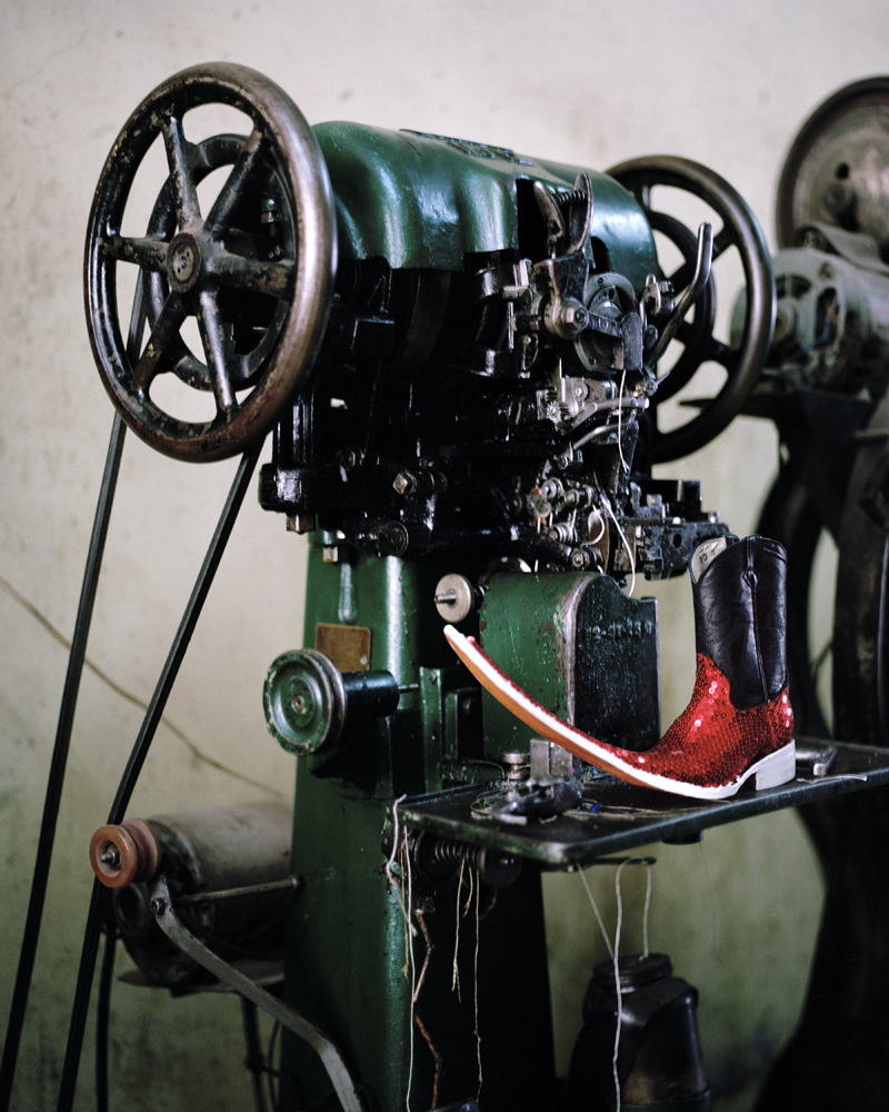 A machine used to repair shoes—and a new shoe—are seen inside the  Erika  shoemaker shop of Matehuala.