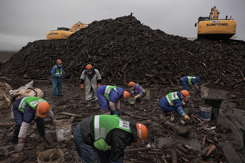 Feb. 23, 2012. Rikuzentakata, Japan. Sorting debris for recycling.