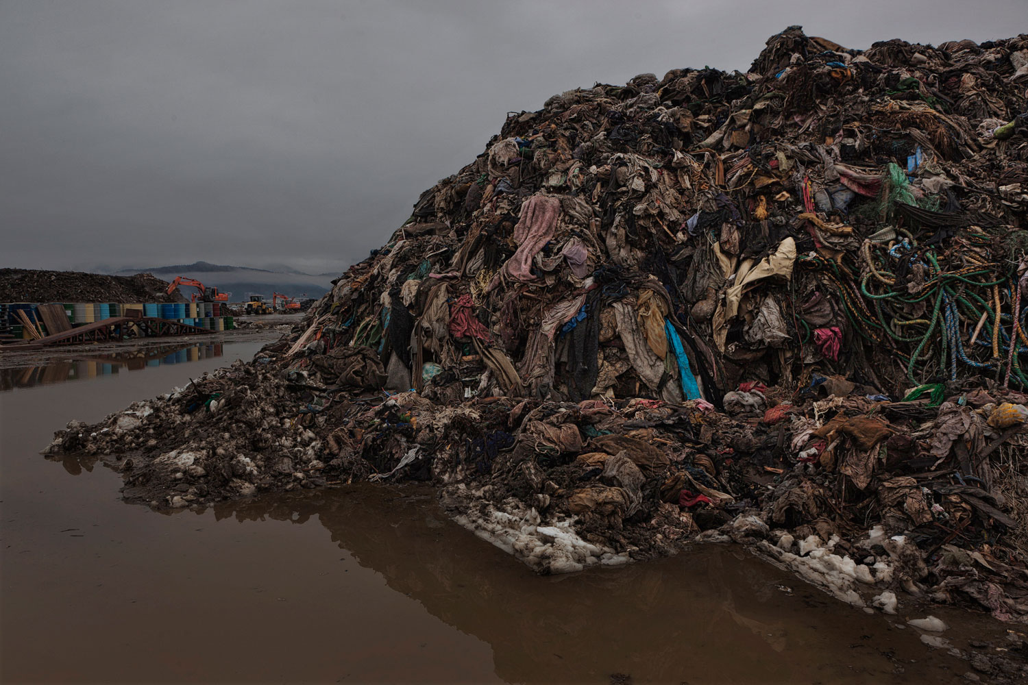 Feb. 23, 2012. Rikuzentakata, Japan. Mountains of clothes and household textiles that cannot be recycled.