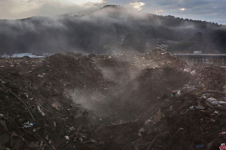 Feb. 23, 2012. Rikuzentakata, Japan. Debris is sorted into piles as the clean-up continues.