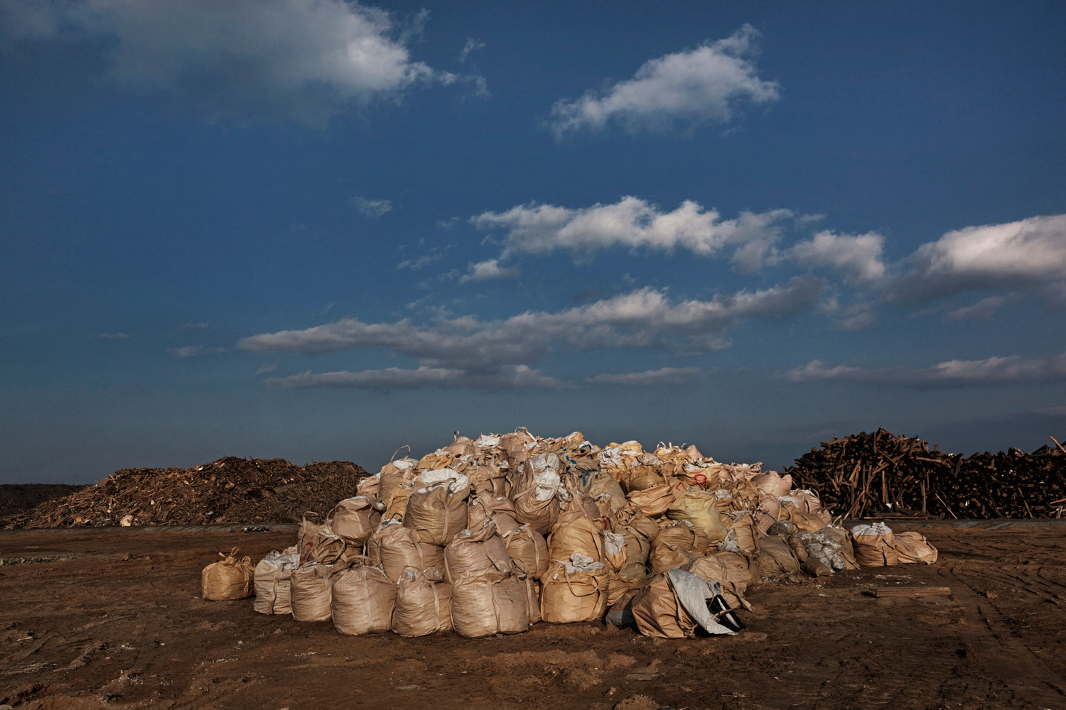 Feb. 24, 2012. Rikuzentakata, Japan. A pile of clothing, bedding and household textiles collected from the devastated area that cannot be recycled.