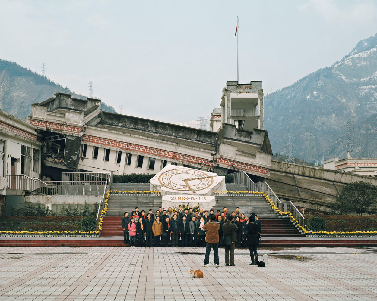Sichuan Wenchuan earthquake ruins tour – China. 2009.Visitors in front of Xuankou middle school, where over 53 died, and Xuankou grade school, where about 250 died.