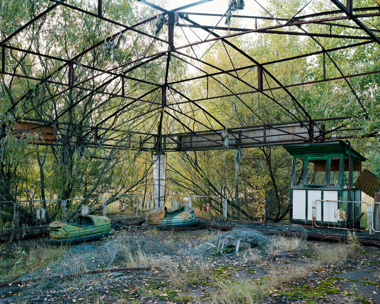 Trip to Chernobyl – Ukraine. 2008.Funfair in Prypiat, a fenced ghost town near Chernobyl. Tours take visitors to the closed zone within a radius of 30 km from Chernobyl station. Tourists can be photographed against the background of the 4th reactor.