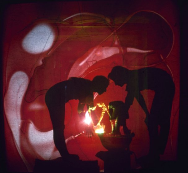Artists Rudi Stern (left) and Jackie Cassen work on a psychedelic slide show at the Riverside Museum in New York City, 1966.