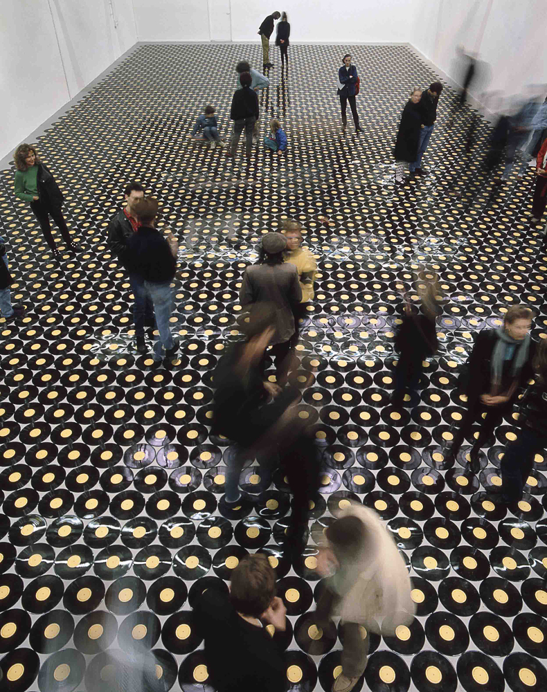 Footsteps, Shedhalle, Zurich, June 4 – July 16, 1989                                                              In 1989, Marclay created the installation Footsteps where visitors were invited to view and step on exposed vinyls containing recordings of footsteps. Following the six-week exhibition, the vinyls, damaged by the all of the foot-traffic, were removed and became recordings of new scratchy rhythms, which were then packaged with a poster of the show and sold as individual pieces.