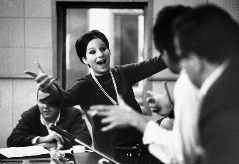 Barbra Streisand in a recording studio in 1966, listening to herself sing.