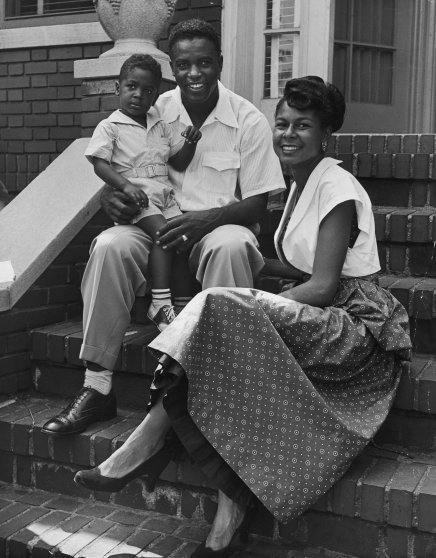 Jackie Robinson holds his son, Jackie Jr., as he sits with his wife Rachel on the front steps of their home in 1949. Jackie Jr. struggled with drug addiction as a young man and was killed, at just 24 years old, in a car accident in 1971.