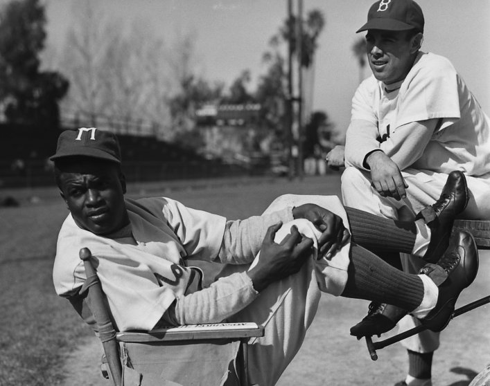 Jackie Robinson relaxes between takes on the set of the 1950 biopic, The Jackie Robinson Story, in which he starred as himself.