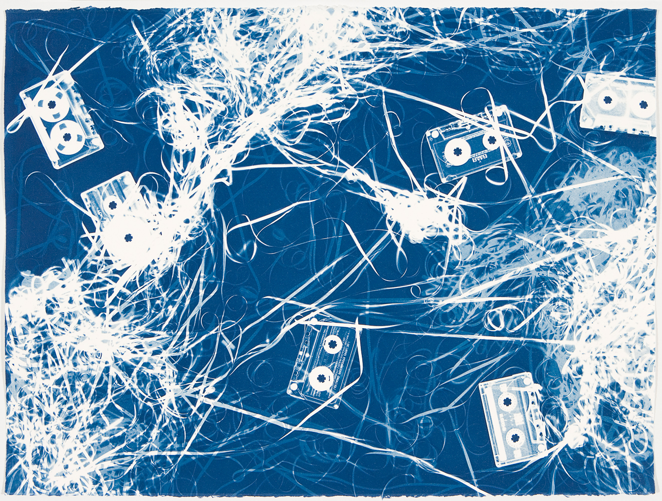 Untitled (Luciano Pavorotti, Halo and Four Mix Tapes II), 2008.                                                              Experimenting with two forms of media that have become obsolete, Marclay created large-scale cyanotypes of cassette tapes strewn and arranged in expressionist compositions.