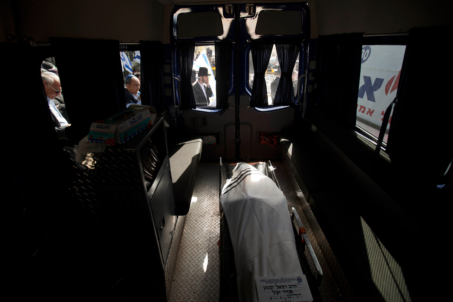 March 21, 2012. The body of Rabbi Jonathan Sandler lies in a hearse at the cemetery during his funeral in Jerusalem. Sandler and three children gunned down at a Jewish school in France were buried Wednesday in a Jerusalem cemetery. The four were killed in the French city of Toulouse when a man on a motorcycle opened fire with two handguns outside the school.