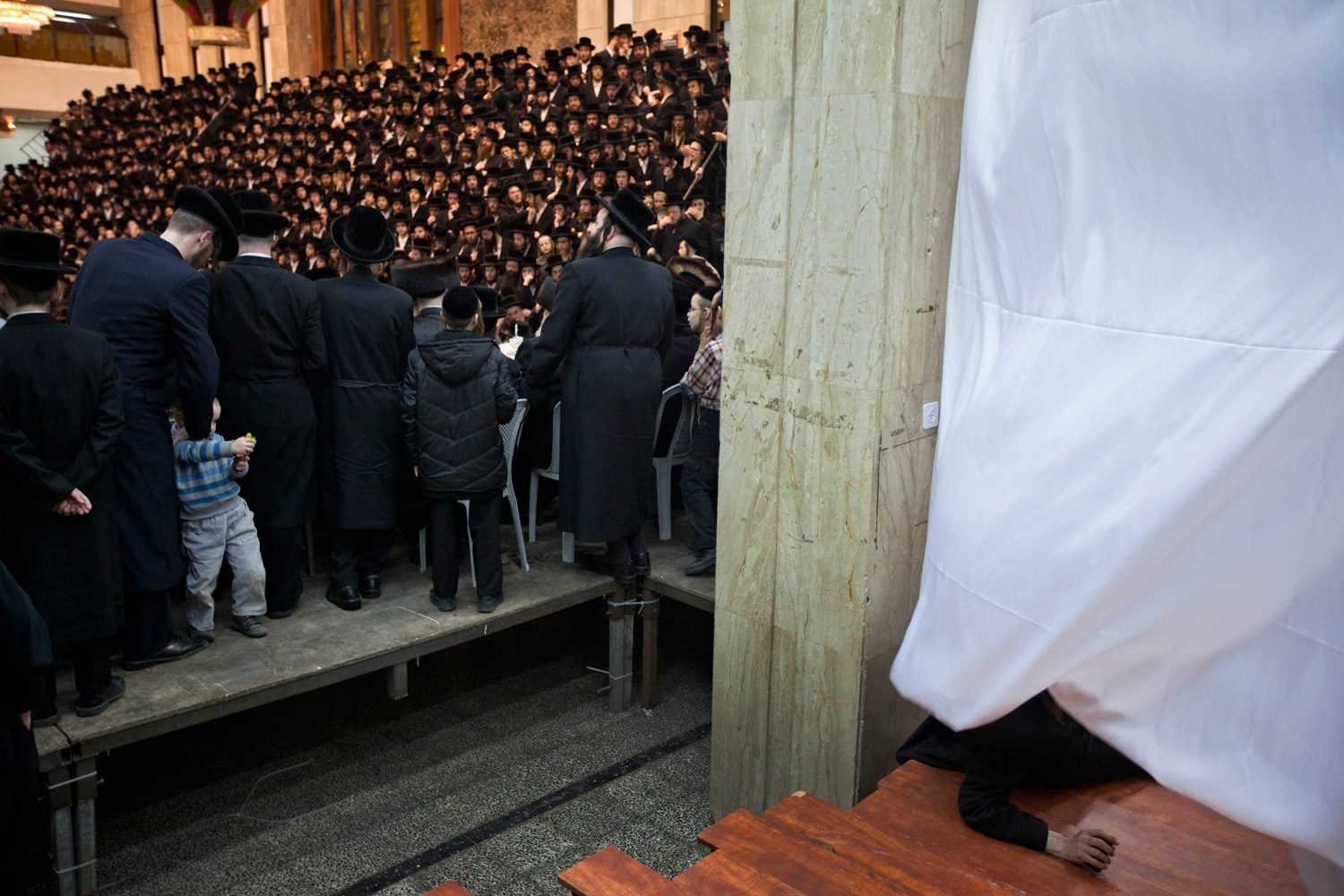 Feb. 8, 2012. Ultra-Orthodox Jews of the Wiznitz Hasidim celebrate the Jewish feast of 'Tu Bishvat' or Tree New Year as they sit with their rabbis around a long table filled with all kinds of fruits, in the ultra-Orthodox town of Bnei Brak near Tel Aviv.
