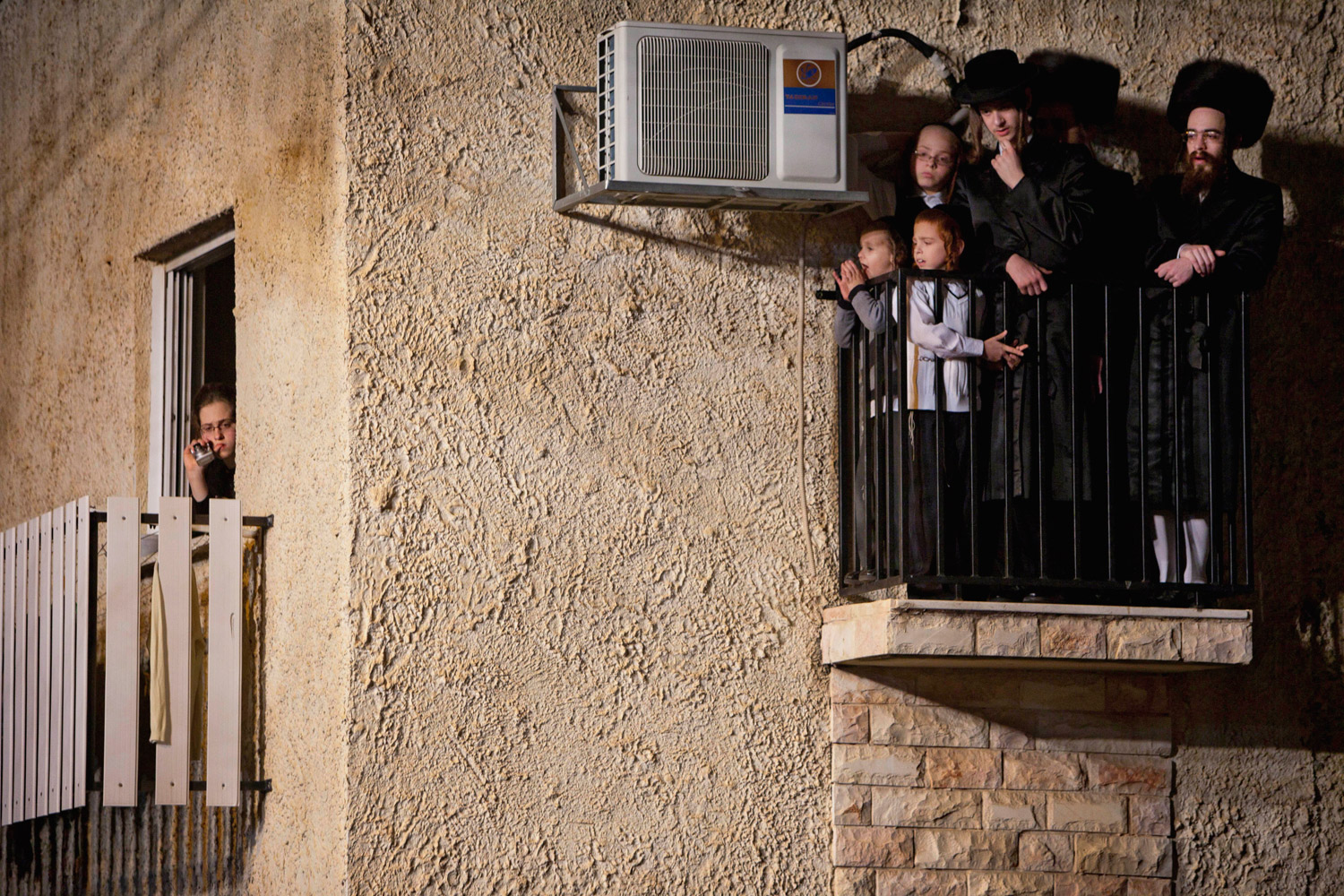 Feb. 14, 2012. Ultra-Orthodox Jews gather for the traditional Jewish wedding of Chananya Yom Tov Lipa, the great-grandson of the Rabbi of the Wiznitz Hasidic followers, in the town of Bnei Brak near Tel Aviv.