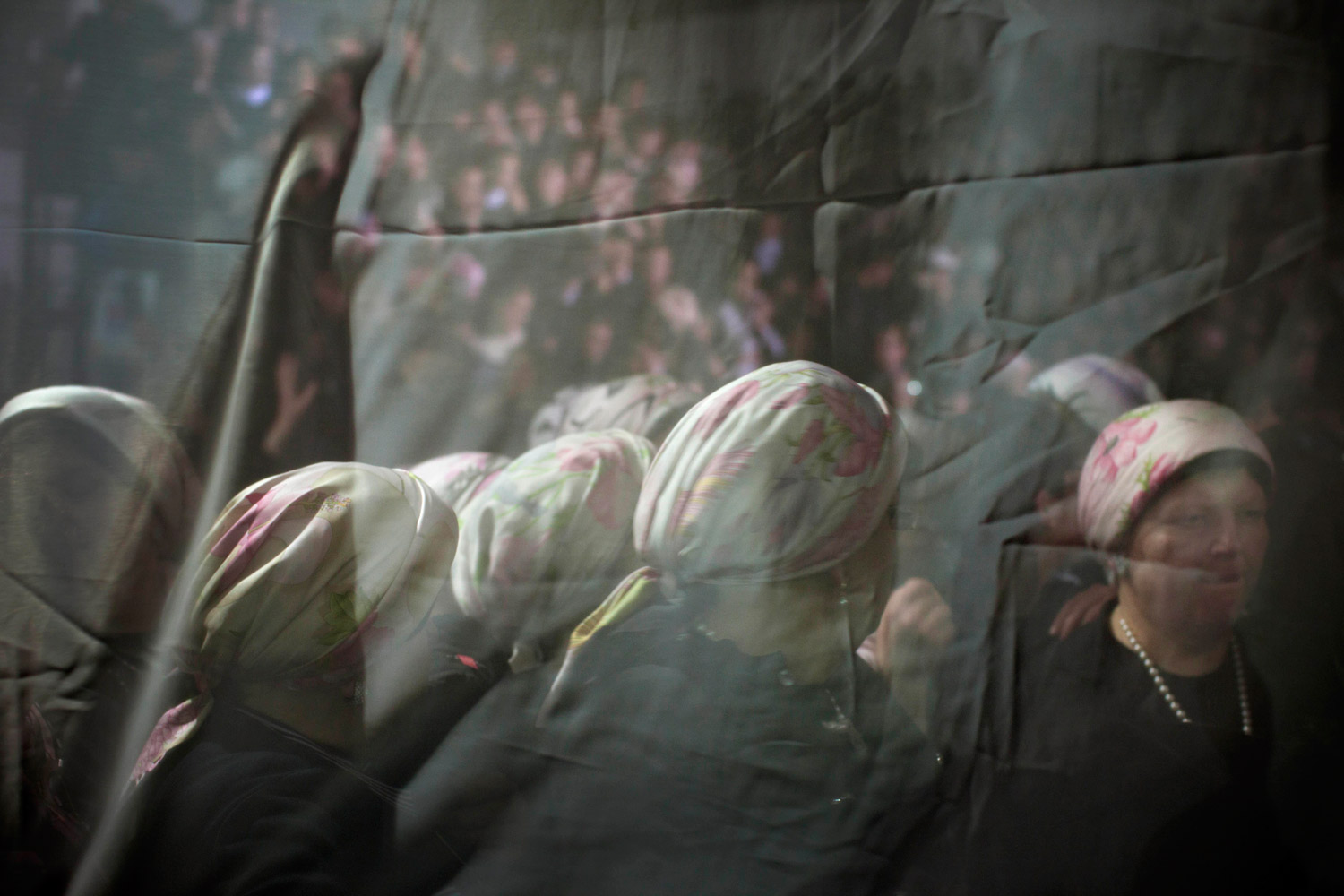 Feb. 14, 2012. Ultra-Orthodox Jewish women are seen behind a curtain during a traditional Jewish wedding for Chananya Yom Tov Lipa, the great-grandson of the Rabbi of the Wiznitz Hasidic followers, in the Israeli town of Petah Tikva near Tel Aviv, Israel.