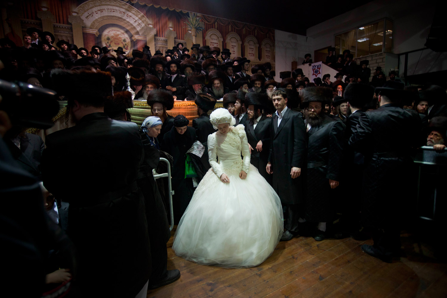Feb. 15, 2012. Ultra-Orthodox Jewish bride Nechama Paarel Horowitz enters the men's section in a wedding hall during her traditional Jewish wedding with Chananya Yom Tov Lipa, the great-grandson of the Rabbi of the Wiznitz Hasidic followers, in the Israeli town of Petah Tikva near Tel Aviv. Nechama entered the men section to fulfill the Mitzvah tantz, in which family members and honored rabbis are invited to dance in front of the bride.