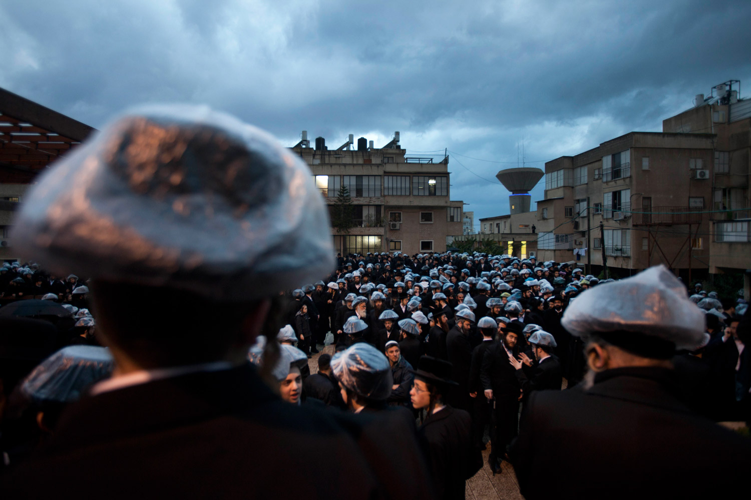 March 1, 2012. Ultra-Orthodox Jewish men carry the body of Rabbi Yaakov Yisachar Ber Rosenbaum from Nadvorna Hasidic rabbinical dynasty during his funeral in the ultra-Orthodox town of Bnei Brak near Tel Aviv. The rabbi was 82 years old.