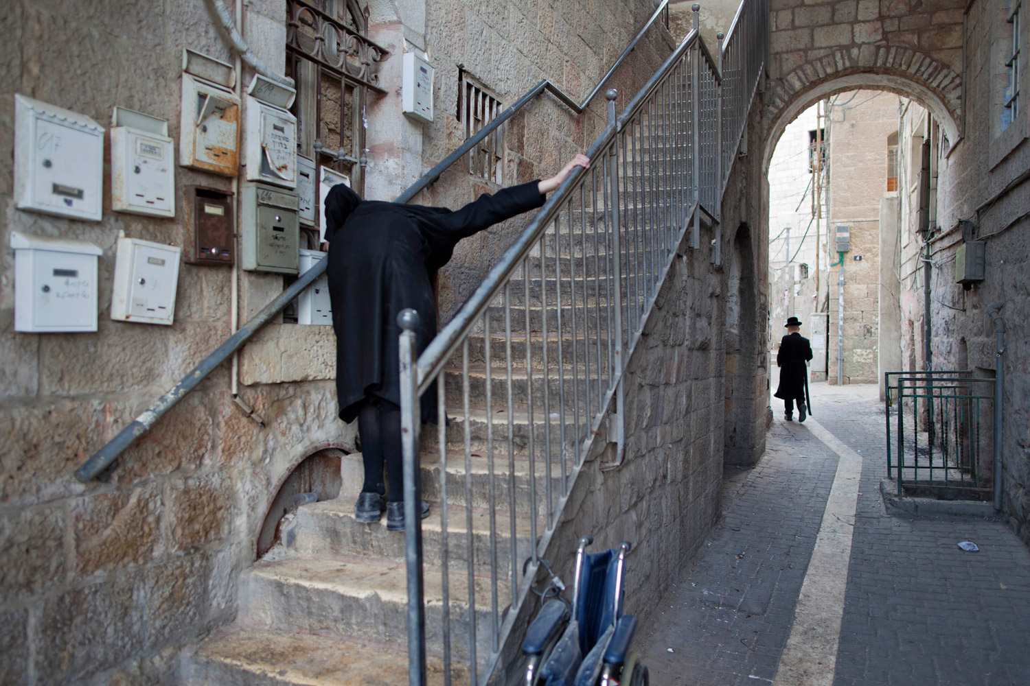 April 3, 2012. An Ultra-Orthodox Jewish man peeks into a house in the Ultra-Orthodox neighborhood of Mea Shearim in Jerusalem.