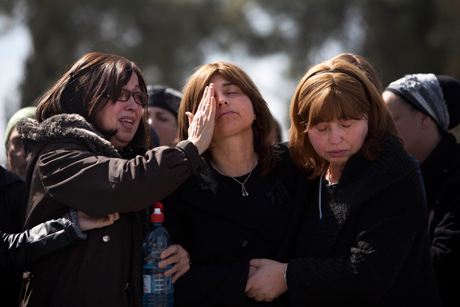 March 21, 2012. At a cemetery in Jerusalem, family members react during a funeral for the victims of a school shooting in Toulouse, France.