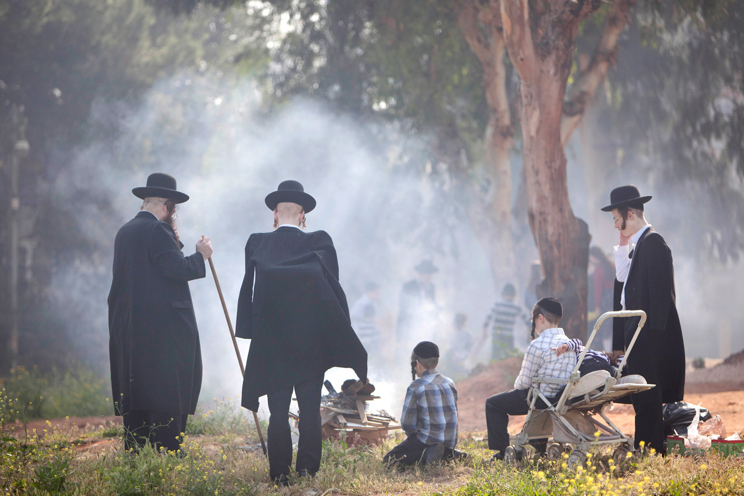 April 6, 2012. Ultra-Orthodox Jewish men burn leavened items in a final preparation before the Passover holiday in the ultra-Orthodox Jewish town of Bnei Brak, near Tel Aviv. Jews are forbidden to eat leavened foodstuffs during the Passover holiday.