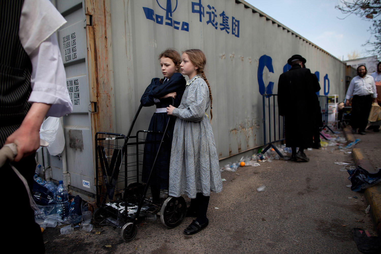 April 3, 2012. Ultra-Orthodox Jewish girls wait for free potatoes to be distributed to large families in preparations for the upcoming Passover holiday in Jerusalem. The week-long festival which commemorates the exodus of the ancient Hebrews from Egypt begins on April 6.