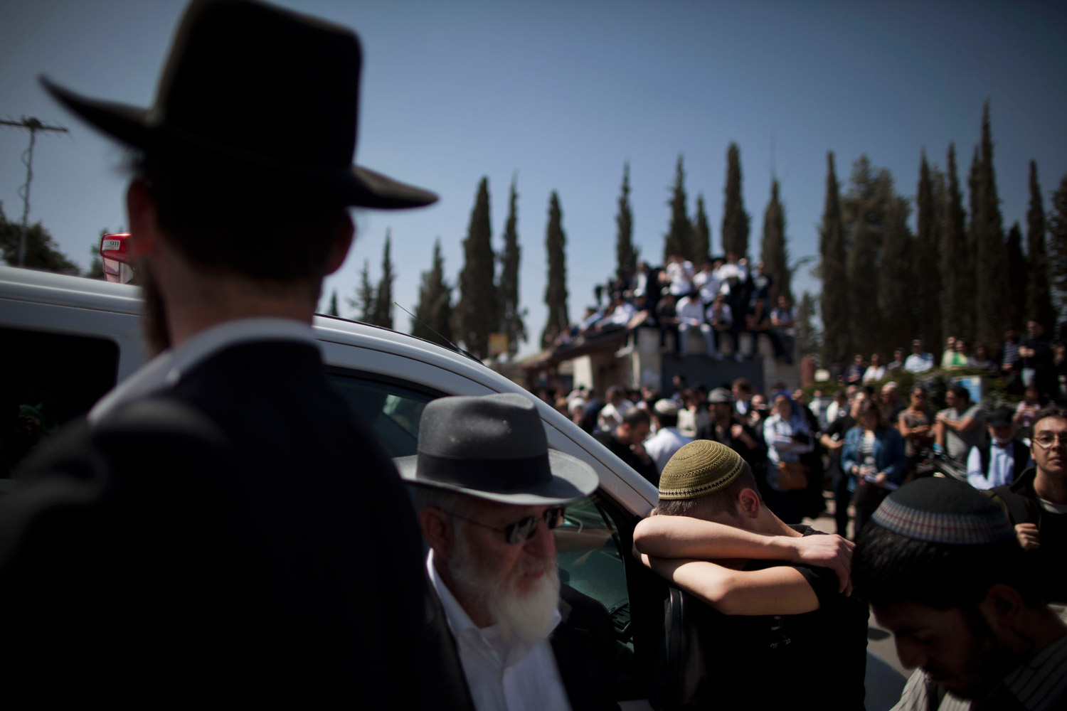 March 21, 2012. At a cemetery in Jerusalem, family members and Israelis react during a funeral for the victims of a school shooting in Toulouse, France.