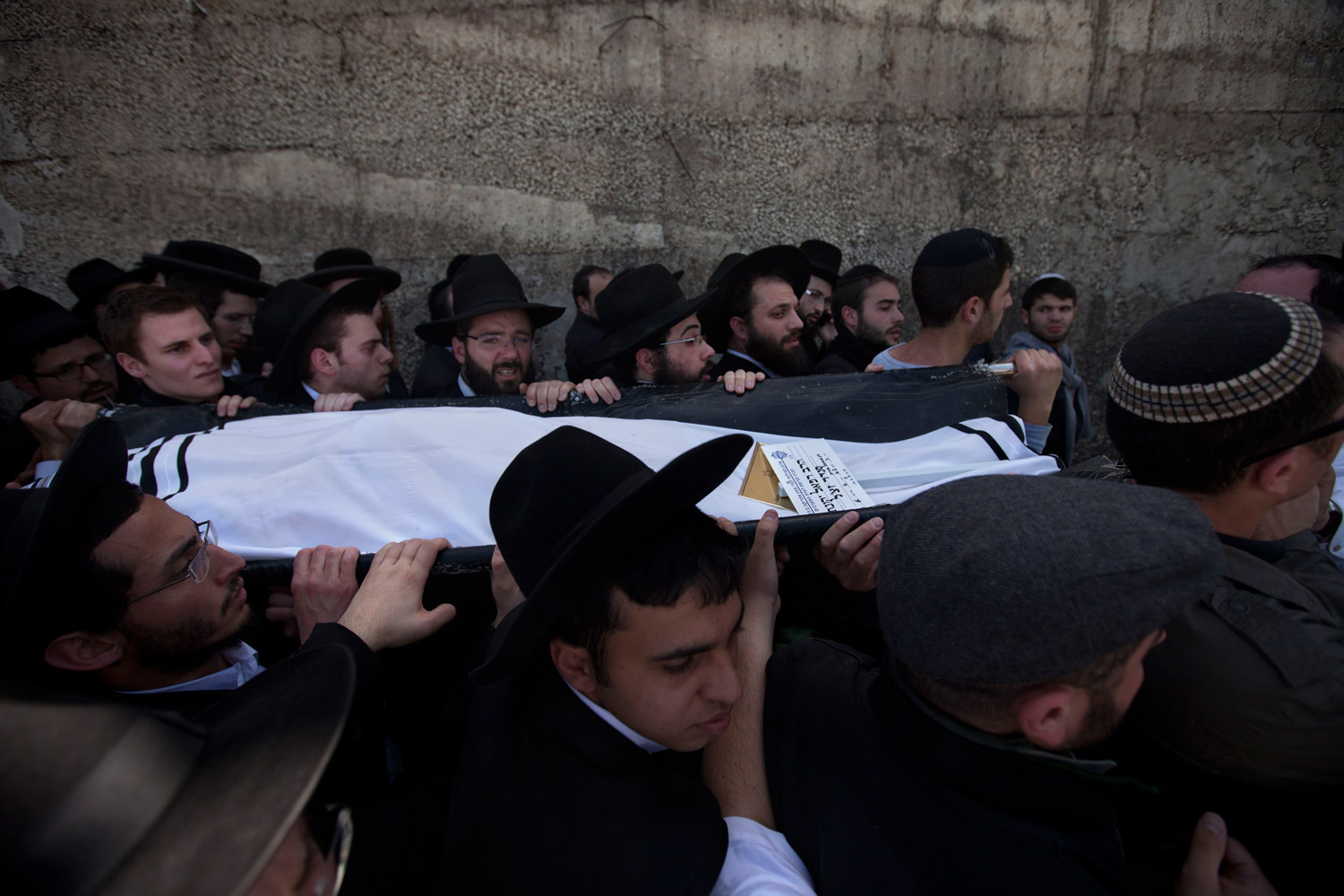 March 21, 2012. Family members and friends carry the body of Rabbi Jonathan Sandler during the funeral of victims of the school shooting in Toulouse. A rabbi and three children gunned down at the Jewish school in France were buried Wednesday in a Jerusalem cemetery.
