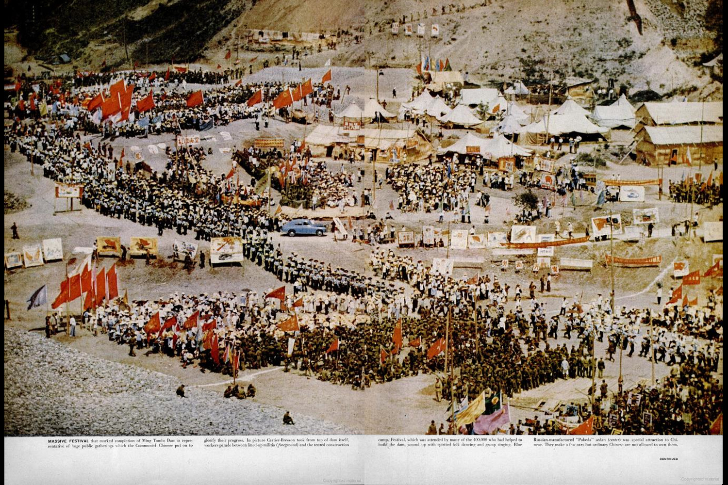 Pages from  Red China Bid for a Future,  featuring photographs by Henri Cartier-Bresson, as the article appeared in the January 5, 1959, issue of LIFE. Massive festival that marked completion of Ming Tombs Dam ... Cartier-Bresson took picture from the top of the dam itself. Blue Russian-made  Pobeda  sedan (center) was special attraction to Chinese. They make a few cars but ordinary Chinese are not allowed to own them.  (NOTE: This gallery is best viewed in  full screen  mode. See button at right.)
