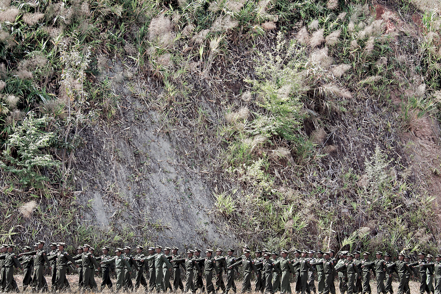 KIA officers perform a military training at the School of Officers, situated in a secret location in the high mountains some kilometers away from Laiza city, the headquarters of the rebel Kachin Independence Army.