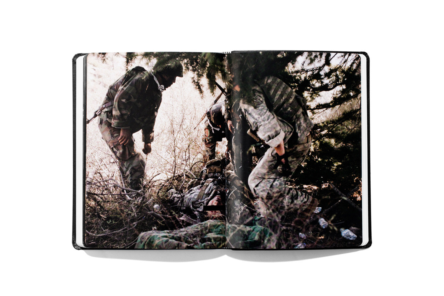 Larry Rougle from Tim Hetherington's 2010 book Infidel. Hetherington mentions his photographs from Afghanistan in the essay below.