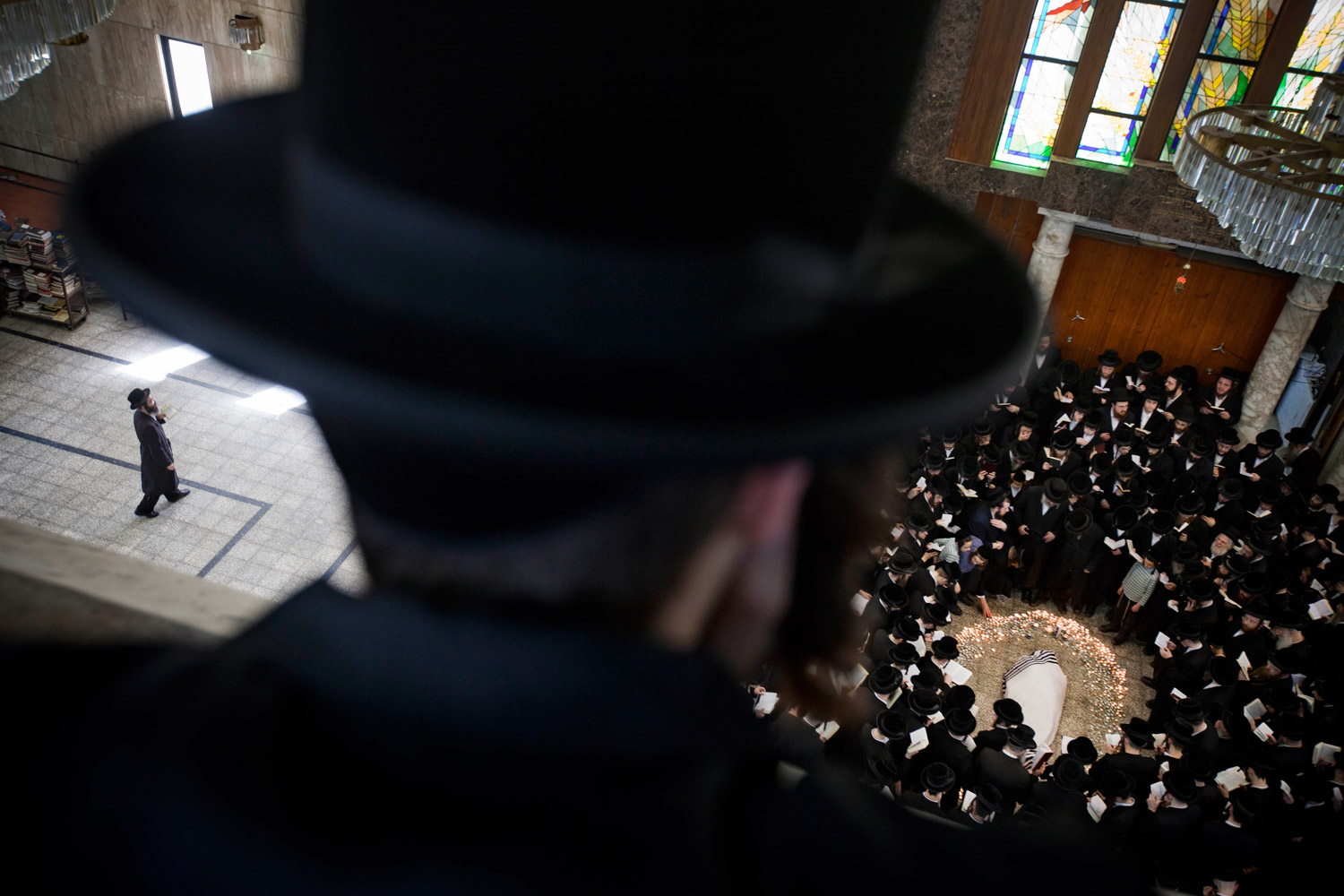 March 14, 2012. Ultra-Orthodox Jews gather around the body of Rabbi Moshe Yehoshua Hager, leader of the Hassidic sect Vizhnitz in Israel, at the Vizhnitz Synagogue during his funeral procession in Bnei Brak, Israel, Wednesday, March 14, 2012.