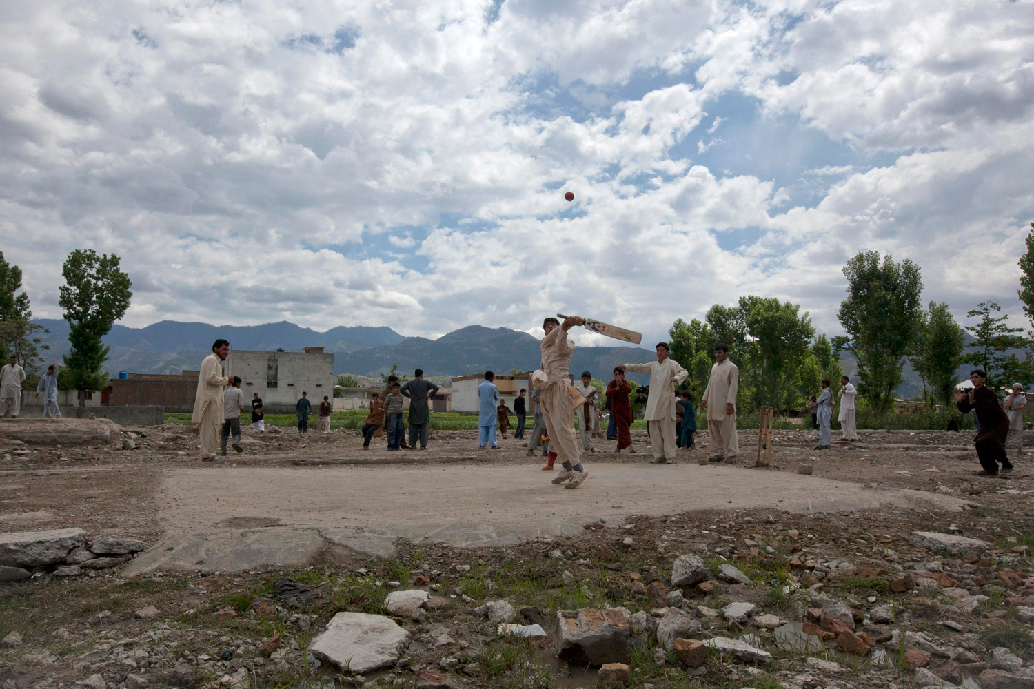 May 1, 2012. Children play cricket on the demolished site of the compound of Osama bin Laden in Abbottabad, Pakistan.