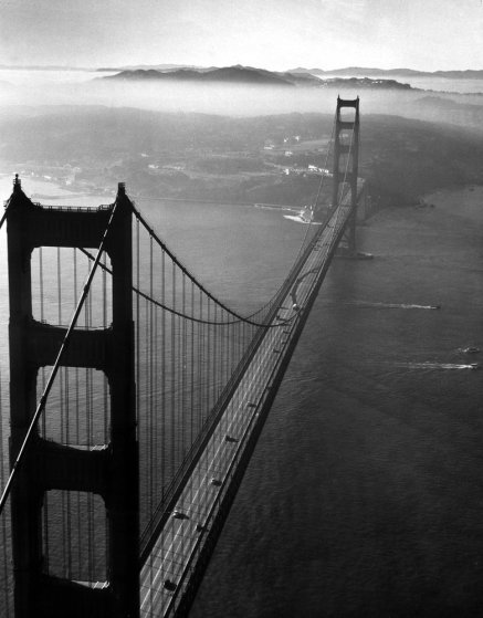The Golden Gate Bridge (with San Francisco in the background) in 1950.