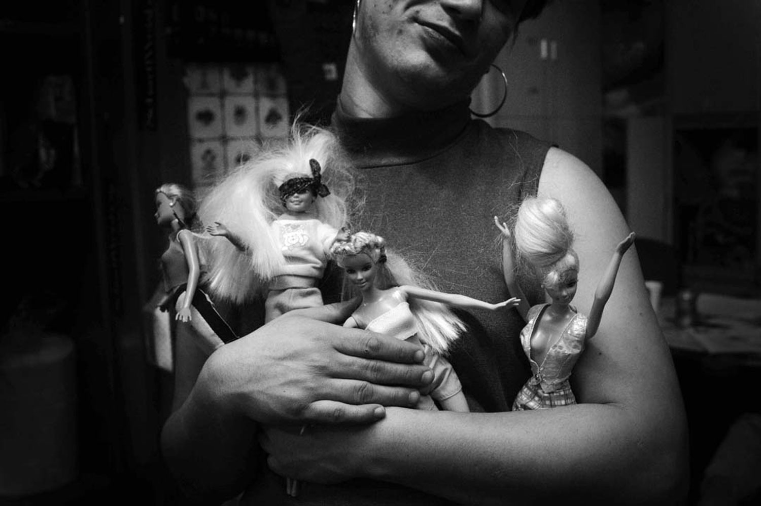 J. holds D.'s Barbie doll family during drop-in hours at Sylvia's Place, New York City's only emergency shelter for homeless LGBT youth. January 2006.