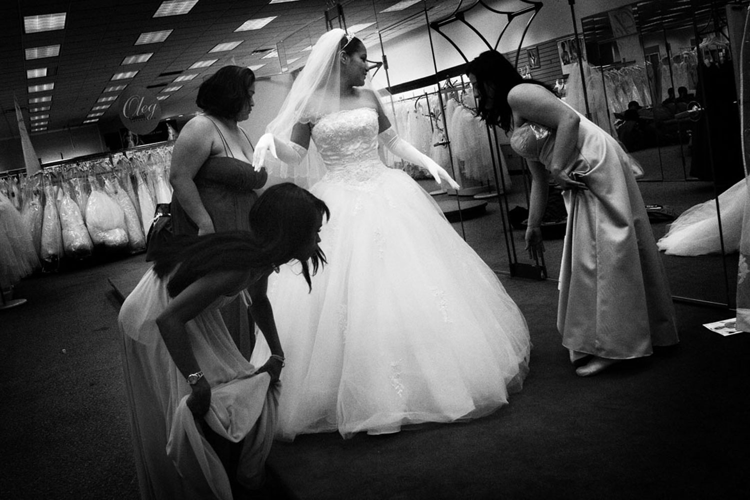 M. tries on wedding dresses with her chosen sisters: J., K. and C., in anticipation of her wedding to her fiancee. May 2007.