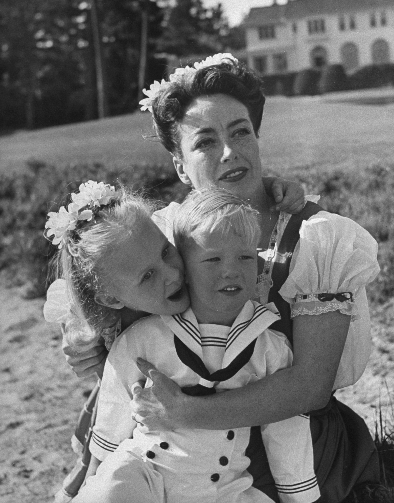 Joan Crawford and two of her children, Christina and Christopher, on the beach, Monterey, California, 1945.