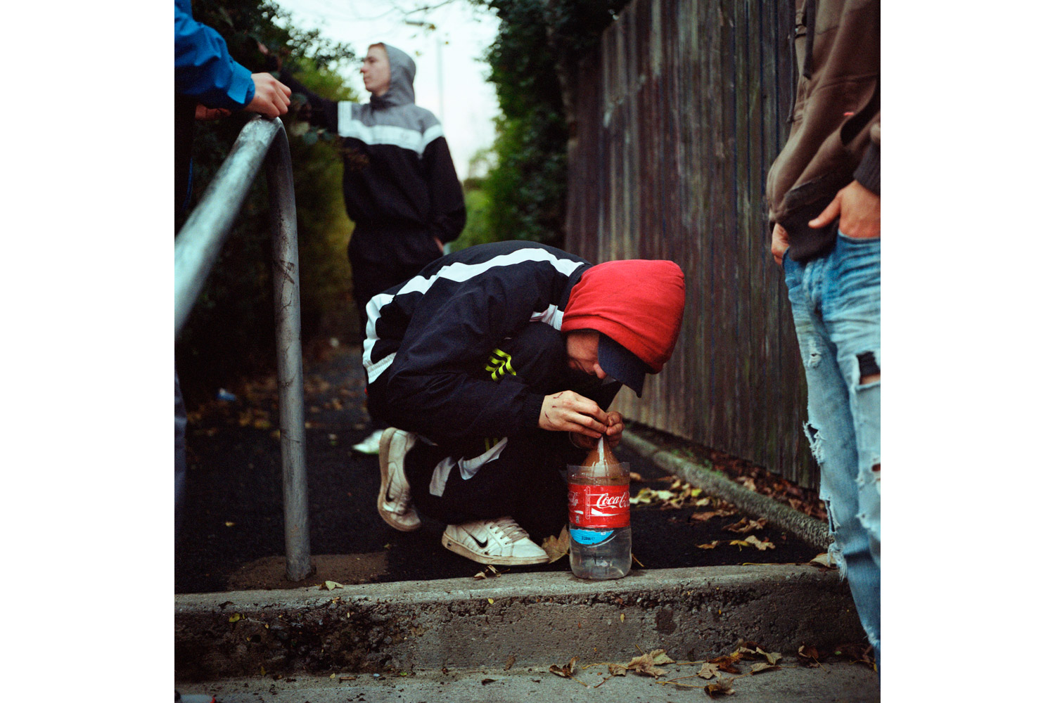 Youth in the Ballysillan area of North Belfast smoke marijuana in an alley. Many young people resent paramilitary groups like the UDA, partly because the groups now refuse to take on new recruits. 2010.