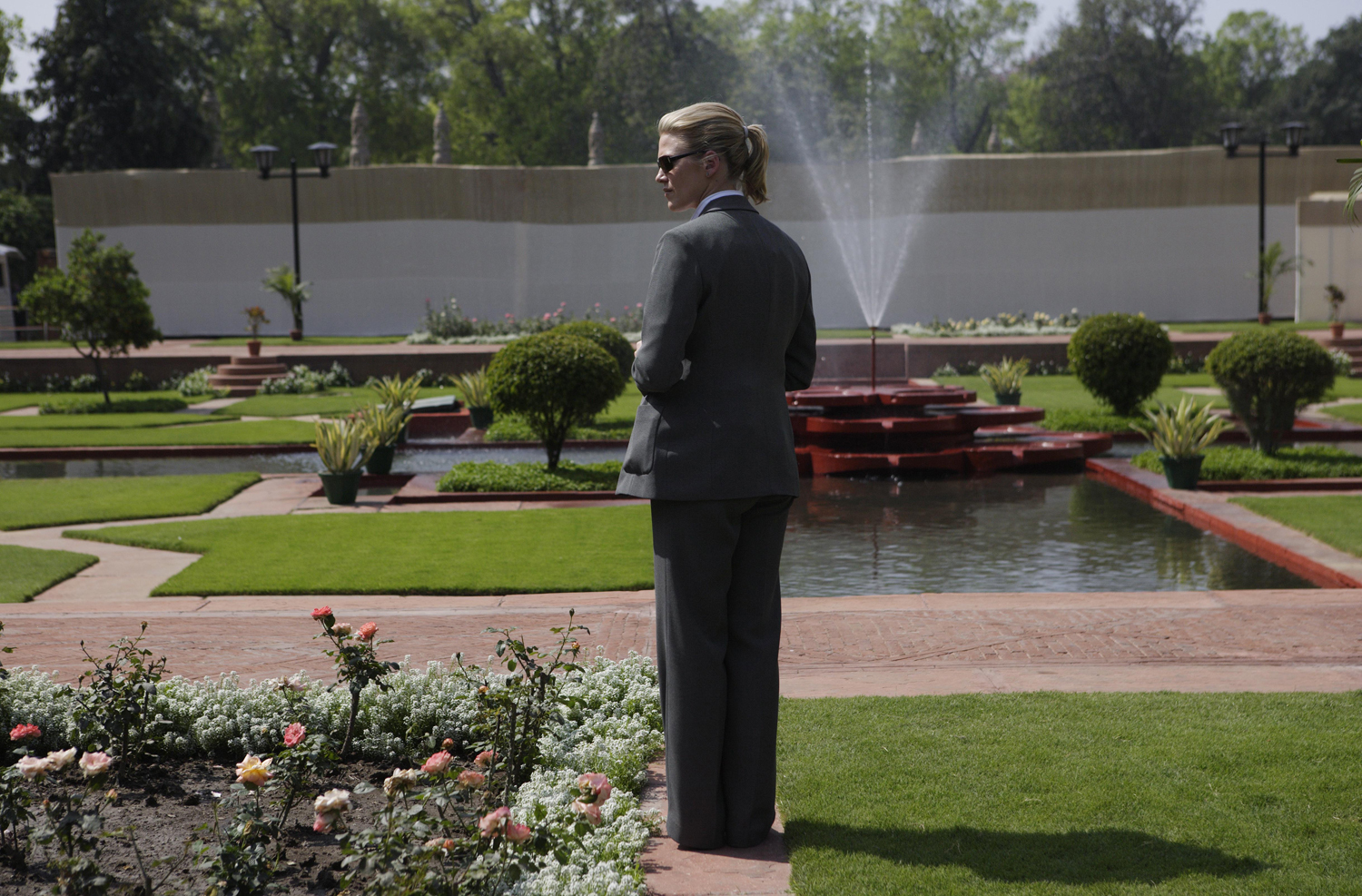 March 2, 2006. A U.S. Secret Service agent stands in a garden during a joint news conference by President George W. Bush and Indian Prime Minister Manmohan Singh in New Delhi.