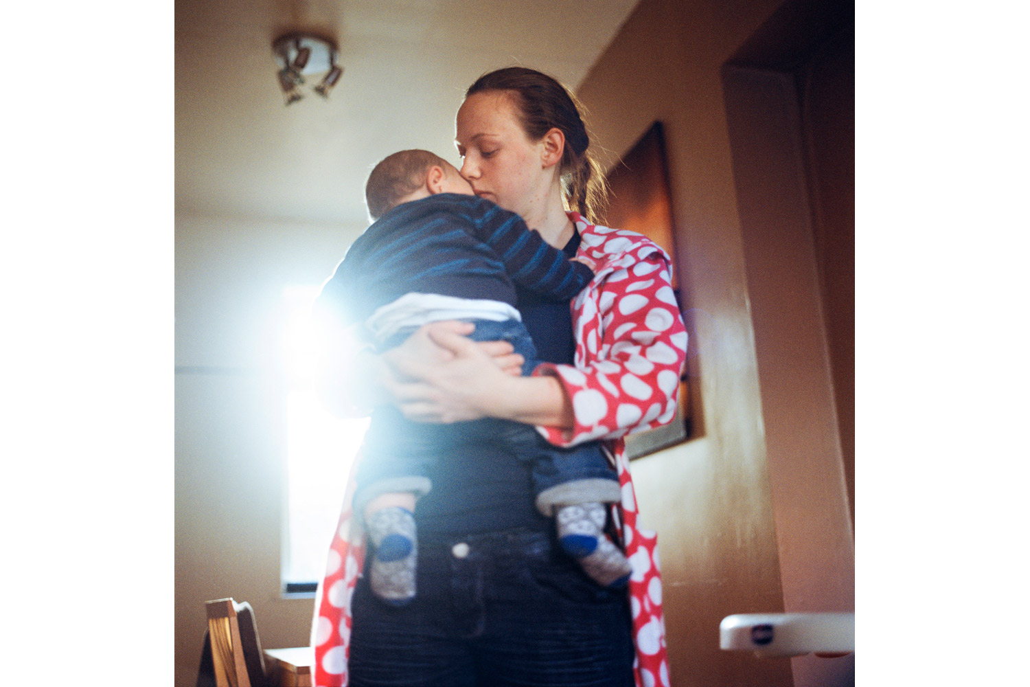 Maxine holds her youngest son Cohen at their home in Tigers Bay. 2010.
